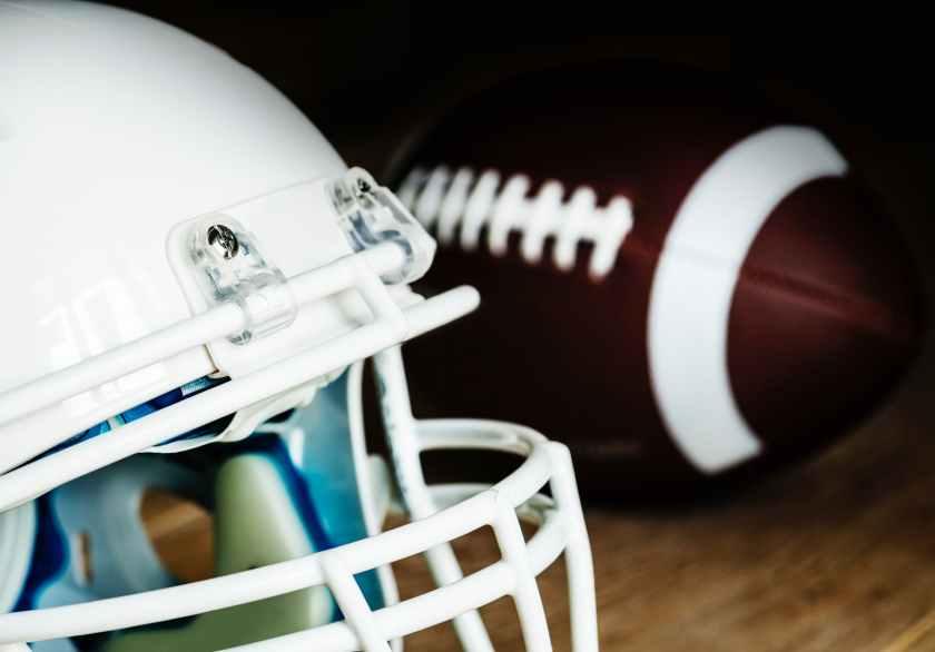 white american football helmet and pigskin ball