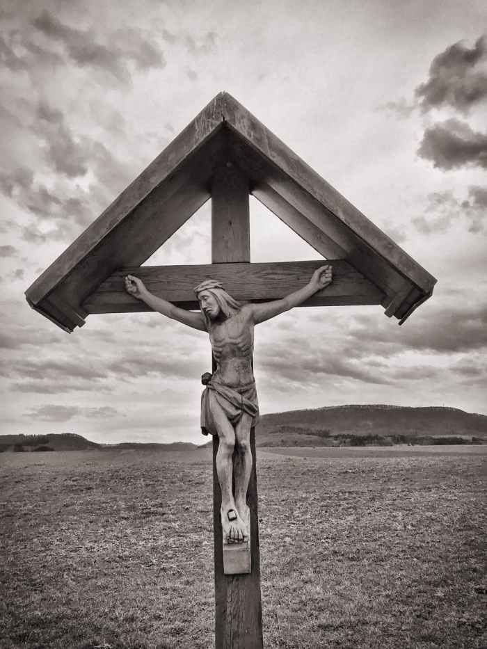 crucifix grayscale photo